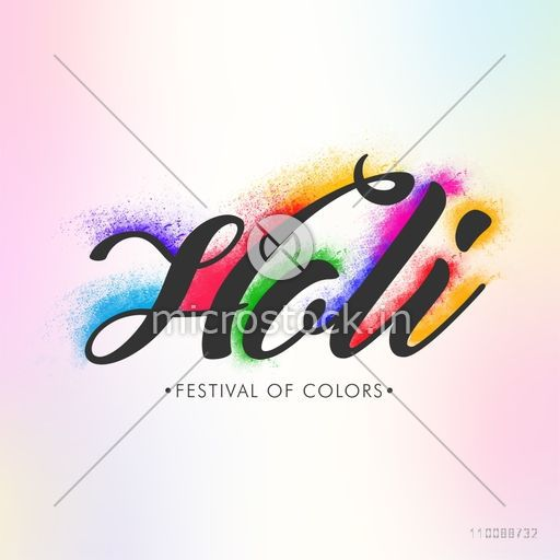 Creative Text Holi with color explosion on shiny background for Indian Festival celebration concept.