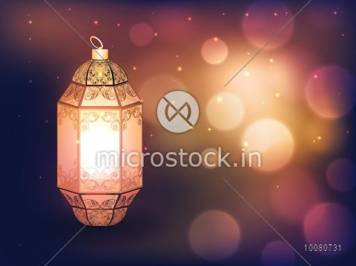 Beautiful floral design decorated, Traditional Lamp on defocused bokeh lights background.