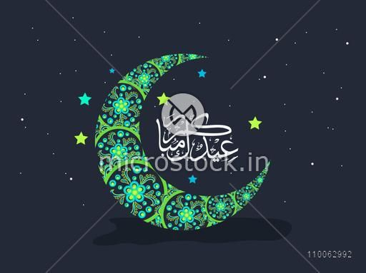 Beautiful floral design decorated green crescent moon with Arabic calligraphy on stars decorated background for Muslim community festival, Eid celebration.