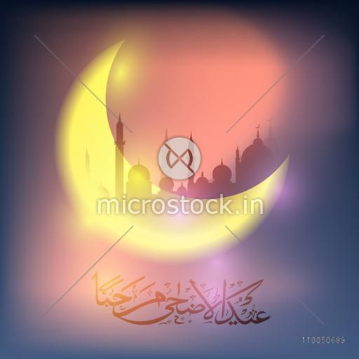 Beautiful glossy moon with Arabic Islamic Calligraphy of text Eid-Ul-Adha on mosque silhouetted background.