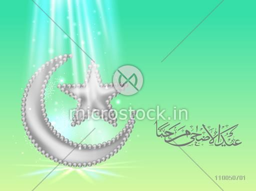 Glossy silver crescent moon and star with Arabic Islamic Calligraphy of text Eid-Ul-Adha for Muslim Community Festival celebration.