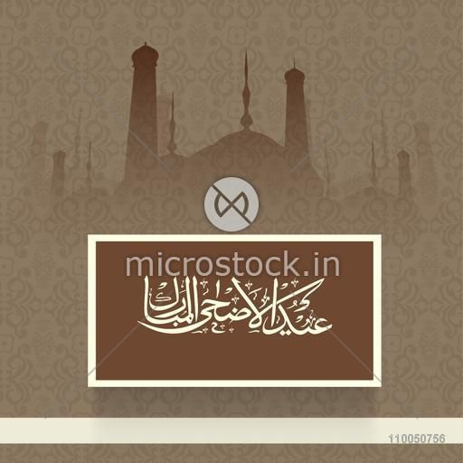 Arabic Islamic Calligraphy of text Eid-Ul-Adha on seamless floral design and Mosque silhouetted background.