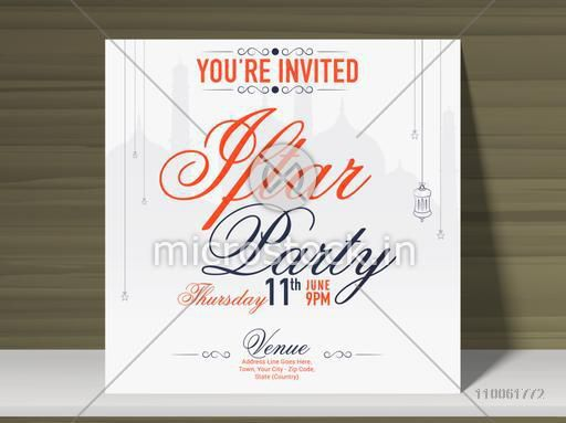 Beautiful invitation card with time, date and place details for holy month of muslim community, Ramadan Kareem celebration on stylish wooden background.