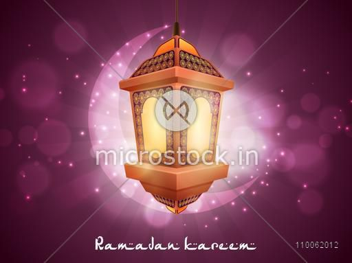 Hanging illuminated arabic lamp with crescent moon on shiny purple background for holy month of muslim community, Ramadan Kareem celebration.