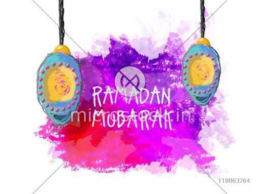 Creative hanging lanterns on colour splash background for Islamic holy month of prayers, Ramadan Mubarak celebration.