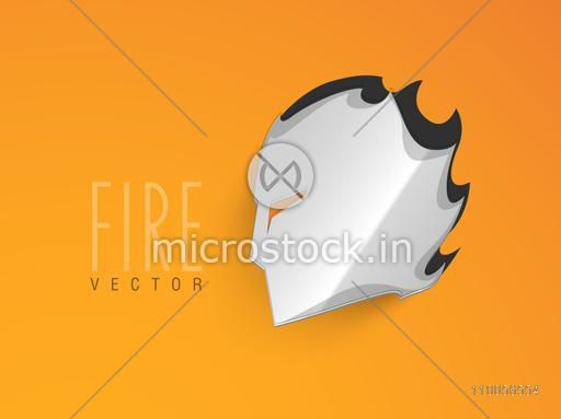 Glossy grey mask with fire effect on bright orange background.