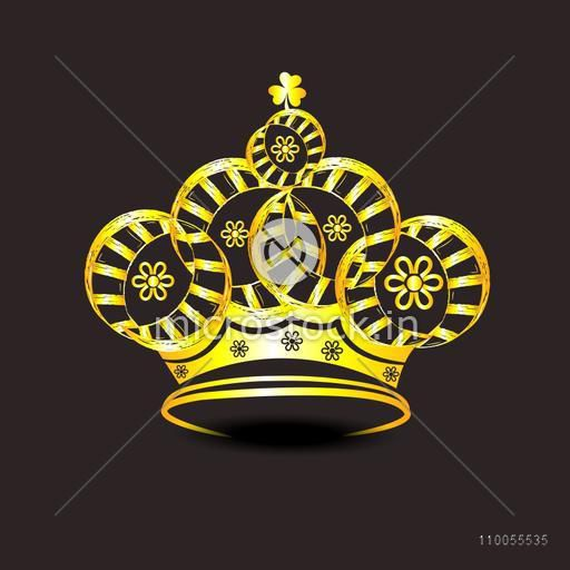 Golden stylish shiny crown isolated on dark brown background.