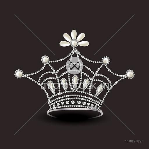 Beautiful diamond crown isolated on dark brown background.