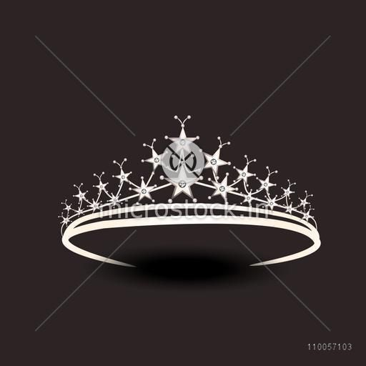 Stylish silver tiara isolated on dark brown background.