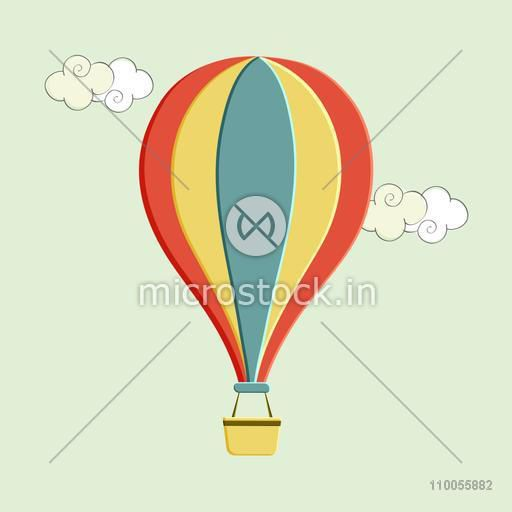 Colorful hot air balloon on mint green background.