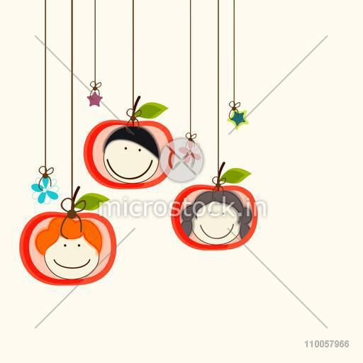 Set of three smiling faces hanging by a rope in apple shaped frame with hanging star and flowers.