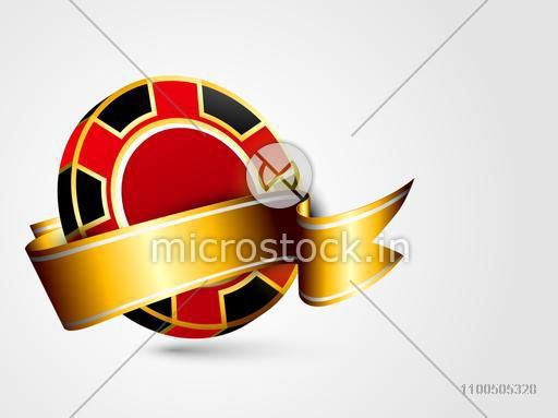 Colorful casino chip covered by glossy golden ribbon on grey background.