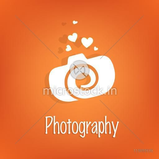 Stylish white camera with hearts on orange background for photography.