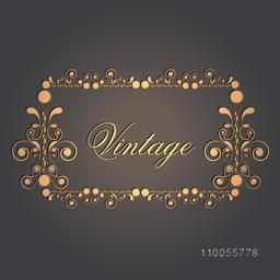 Shiny golden floral decorative vintage frame on grey background, can be used as greeting card or invitation card.
