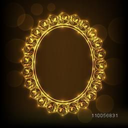 Shiny golden floral design decorated frame in oval shape on brown background.