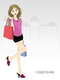Fashionable, shopping girl with bags.