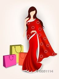 Stand a lady with wearing beautiful red saari and shopping bags on beige colour background.