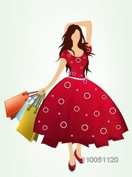 A girl wearing a stylish dress with hold on shopping bags on light shiny green background.