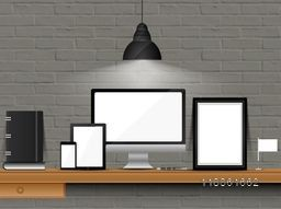 Illustration of a office workspace with modern digital devices mockups in lamp lights on brick wall background.
