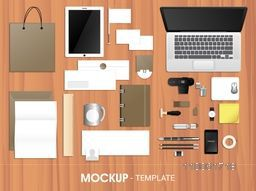Blank corporate identity kit including Letterhead, File Folder, Laptop, Tablet PC, Visiting Cards, Envelopes, Smartphone and Stationery on wooden background.