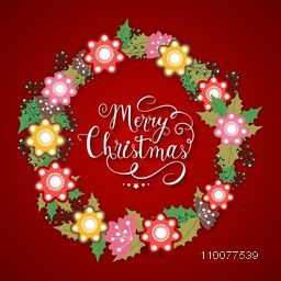 Elegant greeting card design decorated with colorful flowers on red background for Merry Christmas celebration.