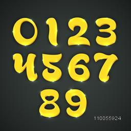 3d numbers in shiny yellow color on dark grey background.