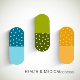 Creative colorful capsules on grey background for Health and Medical concept.
