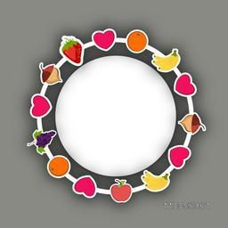 Rounded frame decorated with fruits and heart and blank space for your message.