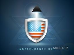 Glossy shield with national flag in light on abstract blue background for American Independence Day celebration.