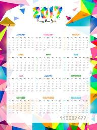 Colorful abstract design decorated, Yearly Calendar layout for Happy New Year 2017 celebration.