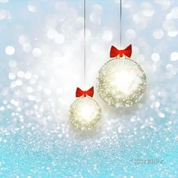 Sparkling silver Xmas Balls hanging on blue glitter background for Merry Christmas celebration.