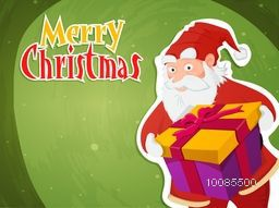 Creative sticky design with illustration of Santa Claus holding big gift box on green background for Merry Christmas celebration.