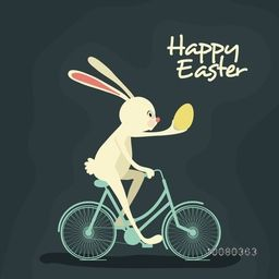Cute cheerful Bunny holding an egg and riding bicycle on occasion of Happy Easter celebration.