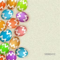 Glossy colorful Eggs on grungy background for Happy Easter celebration.