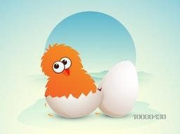 Cute Chick hatching from an egg on nature background for Happy Easter celebration.