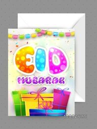 Glossy Colourful Text Eid Mubarak with wrapped gift boxes, Elegant Greeting Card with Envelope for Muslim Community Festival celebration.