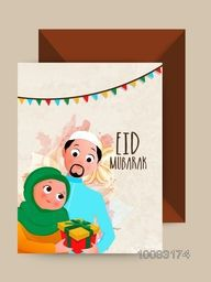 Young religious Islamic Couple with gift, Elegant Greeting Card design with Glossy Envelope for Muslim Community Festival, Eid Mubarak celebration.