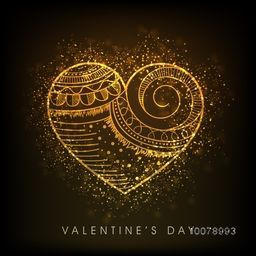 Floral design decorated golden heart on shiny brown background for Happy Valentine's Day celebration.