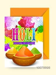 Colorful greeting card design with envelope for Indian Festival of Colours, Happy Holi celebration.