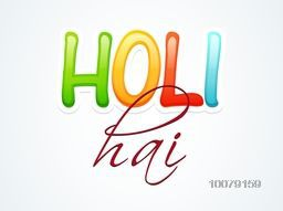 Colorful Hindi text Holi Hai (Its Holi) for Indian festival of colors, Happy Holi celebration.
