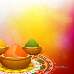 Glossy dry colours in bowls on floral decorated rangoli for Indian Festival, Happy Holi celebration.