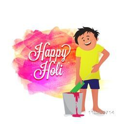 Cute little boy playing color with water gun on occasion of Indian Festival, Happy Holi celebration.