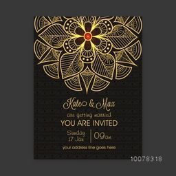 Shiny golden floral design decorated beautiful Wedding Invitation Card.