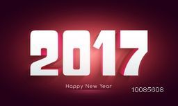3D text 2017 on shiny background for Happy New Year celebration.