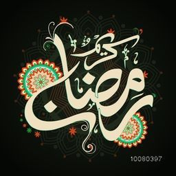 Creative Arabic Islamic Calligraphy of text Ramadan Kareem on beautiful floral design decorated background for Holy Month of Muslim community celebration.