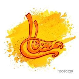 Glossy Arabic Islamic Calligraphy of text Ramadan Kareem on floral decorated yellow paint stroke background for Holy Month of Muslim Community celebration.