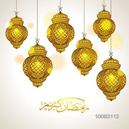 Glowing golden Traditional Lanterns with Arabic Calligraphy text Ramadan Kareem for Holy Month of Muslim Community Celebration.