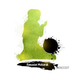 Green silhouette of a Islamic Woman in grunge style Praying for Holy Month of Muslim Community, Ramadan Mubarak.