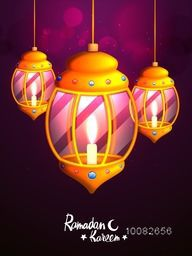 Glowing elegant Traditional Lanterns with illuminated candles on sparkling purple background for Holy Month of Muslim Community, Ramadan Kareem Celebration.