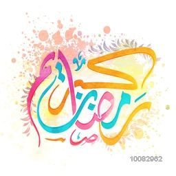 Colourful Arabic Calligraphy text Ramadan Kareem with splash for Holy Month of Muslim Community Festival Celebration.